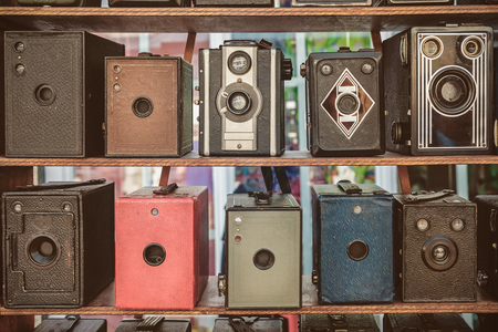 flee: Sepia toned image of old box cameras on a flee market in Doesburg, The Netherlands