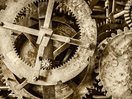 mechanism: Sepia toned detail of a rusty ancient church clock mechanism Stock Photo