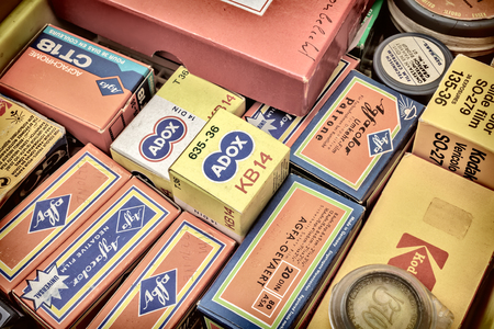 35mm: DOESBURG, THE NETHERLANDS - AUGUST 23, 2015: Retro styled image of old color slide film packs on a flee market in Doesburg, The Netherlands