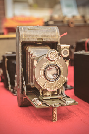 flee: DOESBURG, THE NETHERLANDS - AUGUST 23, 2015: Sepia toned image of an ancient Kodak photo camera on a flee market in Doesburg, The Netherlands Editorial