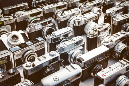flee: DOESBURG, THE NETHERLANDS - AUGUST 23, 2015: Retro styled image of old photo cameras on a flee market in Doesburg, The Netherlands Editorial