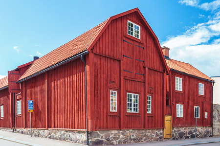 swedish: Ancient red wooden house in the city of Karlskrona, Sweden Stock Photo