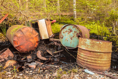Toxic waste barrels left behind in a forest