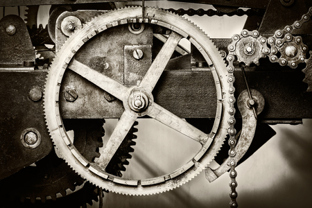 old time: Sepia toned detail of a rusty ancient church clock mechanism Stock Photo