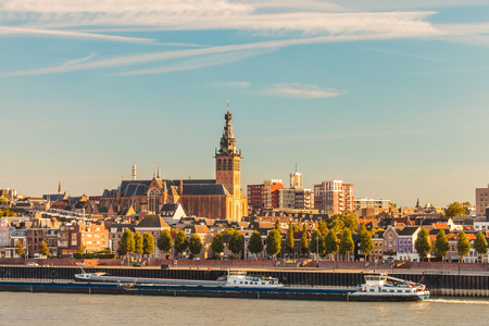The Dutch city of Nijmegen during sunset with the river Waal in front