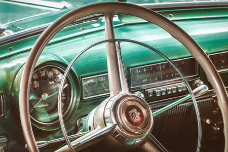 coronet: DREMPT, THE NETHERLANDS - OCTOBER 1, 2015: Retro styled image of the interior of a classic 1951 Dodge Coronet in Drempt, The Netherlands