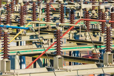 redes electricas: Cerca de una estaci�n de distribuci�n de energ�a el�ctrica con grandes aisladores