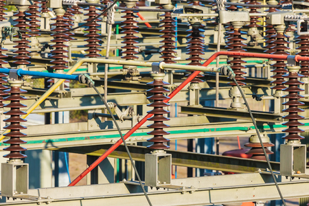 electricity generation: Close up of an electricity distribution station with large isolators