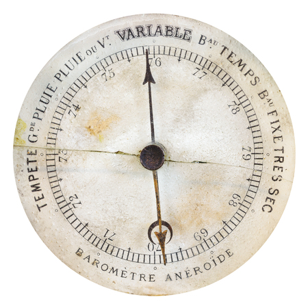 atmospheric pressure: Vintage weathered French barometer isolated on a white background