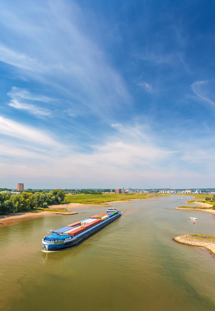 river boat: The Nederrijn river in front of the Dutch city of Arnhem, The Netherlands