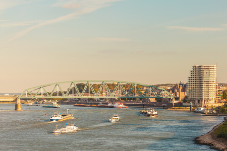 inland waterways: Cargo riverboats passing the Dutch city of Nijmegen in the afternoon