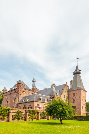 restored: DOORWERTH, THE NETHERLANDS - AUGUST 2, 2015: Summer view of the fully restored medieval castle in Doorwerth, The Netherlands Editorial