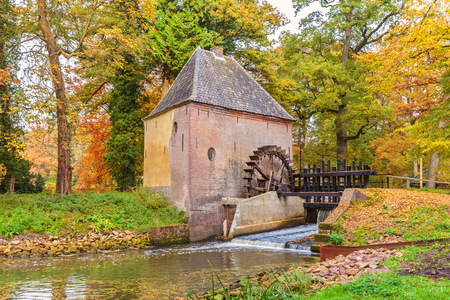 Old water mill in the Dutch province of Gelderland during autumn