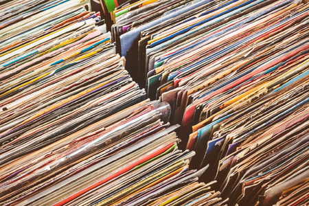 record: Retro styled image of boxes with vinyl turntable records on a flee market
