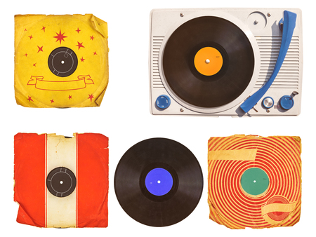 sixties: Old vinyl turntable player with record albums isolated on white