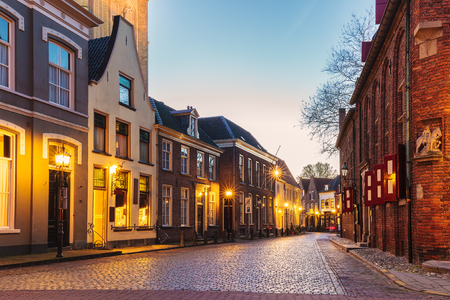 Ancient Dutch street with church in the city of Doesburg during sunset