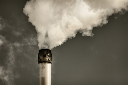 emissions: Retro styled image of air pollution from a factory pipe