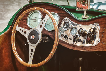 td: DREMPT, THE NETHERLANDS - FEBRUARY 4, 2014: Retro styled image of the dashboard of a 1953 MG TD Roadster in Drempt, The Netherlands.