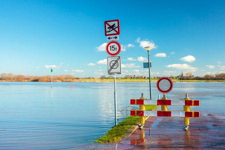 Flooded road in front of the Dutch river IJssel in the province of Gelderland Stock Photo