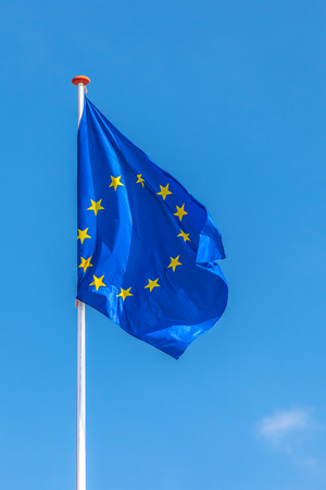 EU: Official flag of the European Union in front of a clear blue sky
