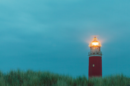 texel: Evening view of the lighthouse at the Dutch island of Texel