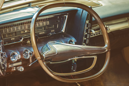 Retro styled image of the dashboard of a classic car