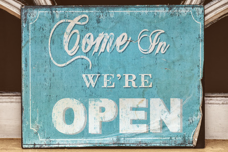 come in: Weathered blue come in were open sign