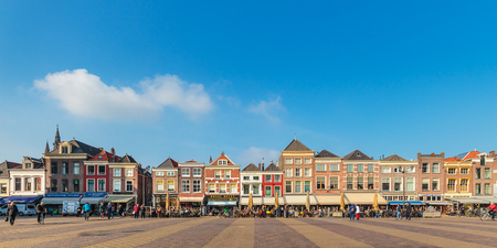 delft: DELFT, THE NETHERLANDS - MARCH 3, 2016: Panoramic view of the central square with ancient houses in Delft, The Netherlands Editorial