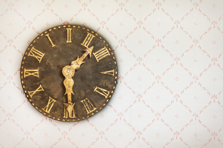 retro wallpaper: Vintage clock hanging on a wall with retro wallpaper