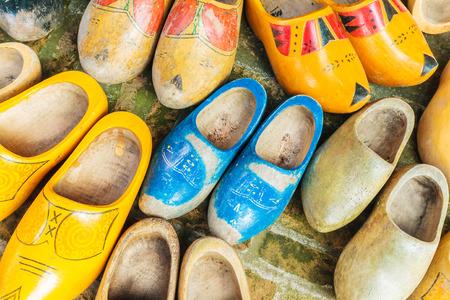 dutch: Set of different colorful vintage Dutch wooden clogs