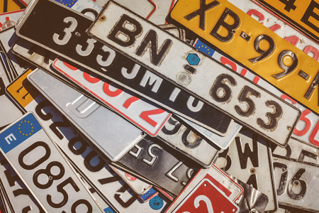 flee: ROSMALEN, THE NETHERLANDS - MAY 8, 2016: Vintage European car license plates on a flee market in Rosmalen, The Netherlands Editorial