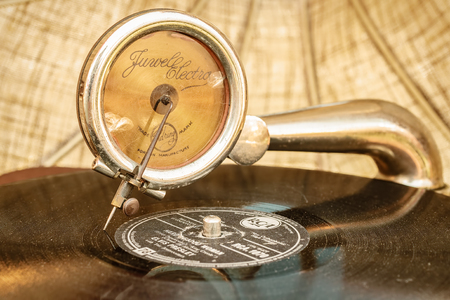 turntable: ROSMALEN, THE NETHERLANDS - MAY 8, 2016: Retro styled image of a playing turntable on a flee market in Rosmalen, The Netherlands Editorial