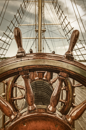 deck: Retro styled image of the steering wheel of a sail boat Stock Photo