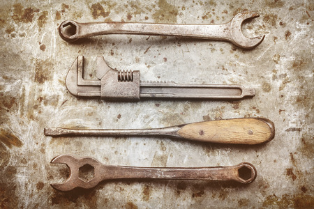 screw driver: Old wrenches and screw driver on a metal background