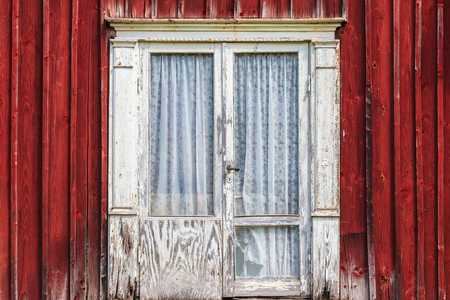 white door: Weathered white door with a red wooden wall of an old Swedish farmhouse