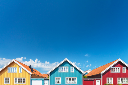 Colorful old swedish houses in front of a blue sky Stok Fotoğraf