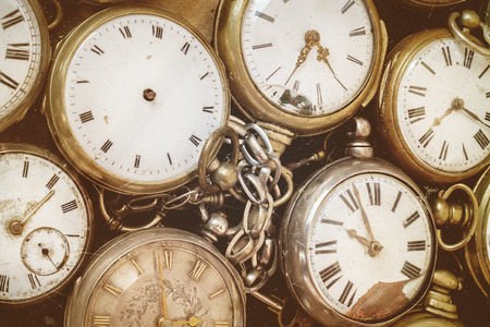 run down: Retro styled image of old scratched and run down pocket watches