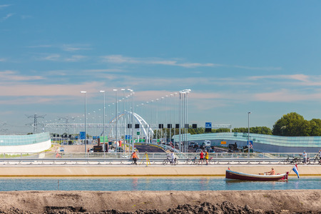 netherlands: DIEREN, THE NETHERLANDS - AUGUST 23, 2016: Construction of the new main highway A1 and crossing water bridge between the cities of Amsterdam and Utrecht in Muiderberg, The Netherlands