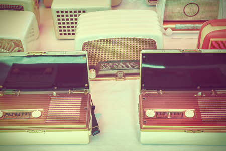 flee: Retro styled image of old radios for sale on a flee market