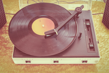 record player: Retro styled image of an old record player on a flee market