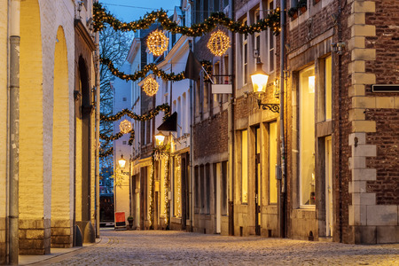 european: Shopping street with christmas lights in the city center of Maastricht, The Netherlands
