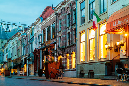 holland: ZWOLLE, THE NETHERLANDS - DECEMBER 7, 2016: Ancient Dutch shopping street with christmas decoration in Zwolle, The Netherlands