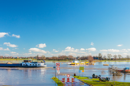 flood area: Flooded road in front of the Dutch river IJssel in the province of Gelderland Stock Photo