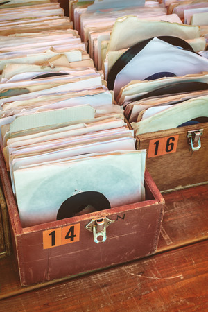 flee: Retro styled image of boxes with vinyl turntable records on a flee market