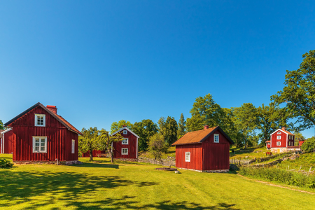 Historic village with ancient red wooden houses in Sweden 版權商用圖片