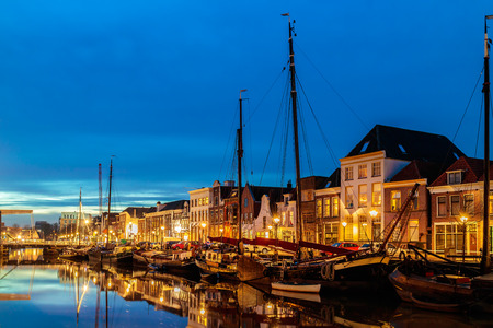 netherlands: Evening view of a Dutch canal with sailing boats in the city center of Zwolle