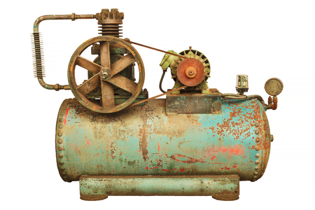 Vintage industrial machine with a green boiler isolated on a white background