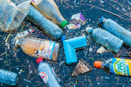 sea pollution: AMSTERDAM, THE NETHERLANDS - MARCH 27, 2017: Plastic waste floating in a canal in Amsterdam, The Netherlands Editorial