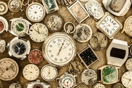 classical mechanics: Retro styled image of a collection of vintage rusty watches and parts Stock Photo