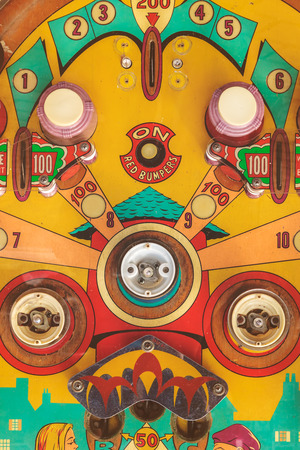 rusts: DEN BOSCH, THE NETHERLANDS - MAY 14, 2017: Close up of a weathered vintage pinball machine on a flee market in Den Bosch, The Netherlands